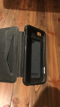 Black iPhone otterbox flip case and card holder