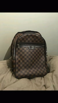 brown and black Louis Vuitton leather backpack Burnaby, V5H 4M1