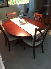 Oval brown wooden table with four chairs dining set Winter Springs, 32708