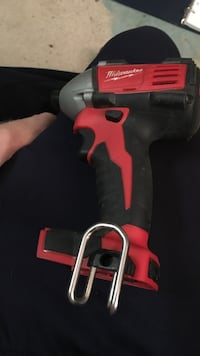 Black and red milwaukee cordless impact driver
