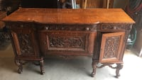 Brown wooden sideboard will deliver if local