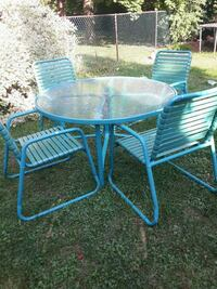 round clear glass top table with four chairs patio Oakville, L6L 2W4