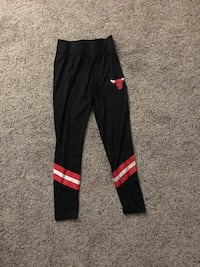 black and red Adidas track pants