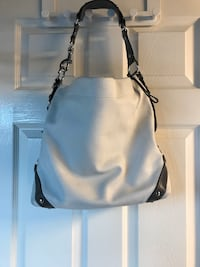 White and grey Coach bag.