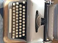 gray and brown Reminton electric typewriter