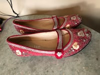 Pair of red floral flat shoes size 6