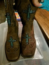 pair of brown leather cowboy boots Dallas, 75250