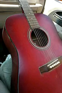red and black acoustic guitar Nampa, 83651
