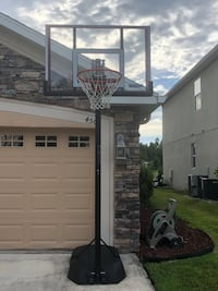 white and black basketball hoop Wesley Chapel, 33543