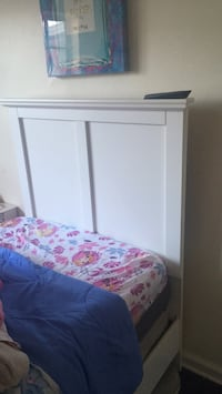 White wooden bed frame with pink and white bed sheet Arlington, 22203