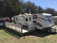 White and black puma camper trailer