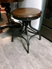 Bar stool with solid wood seat and legs are black metal...I LOVE IT!!! Westwego