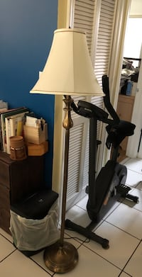 white floor lamp with brass base