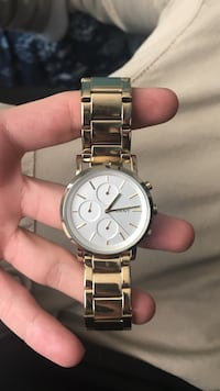 Round silver DKNY chronograph watch with link band