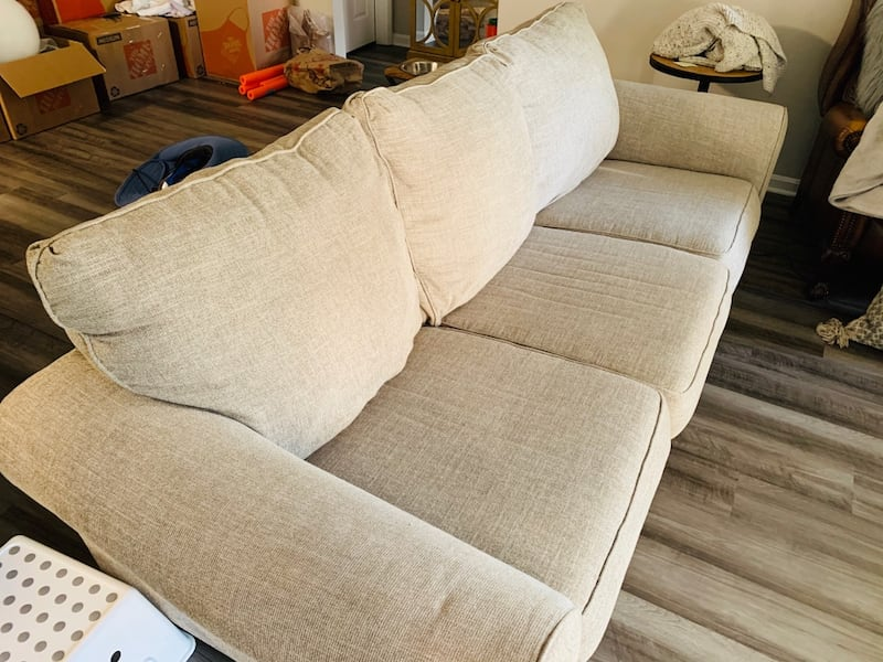 Ashley Furniture 9' three seater couch great condition 42d347f4-daea-4f68-9c67-abb0061edeee