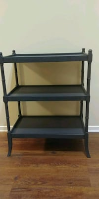 Newly refinished wooden bookcase