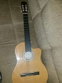 Tan wood acoustic guitar