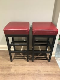 two red leather padded bar stools Toronto, M9A 2E5