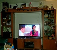 flat screen television with brown wooden TV hutch Toronto, M9V 4S7