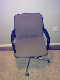 Black and gray rolling armchair. Fargo, 58102