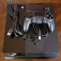 Black sony ps4 with controller 43 km