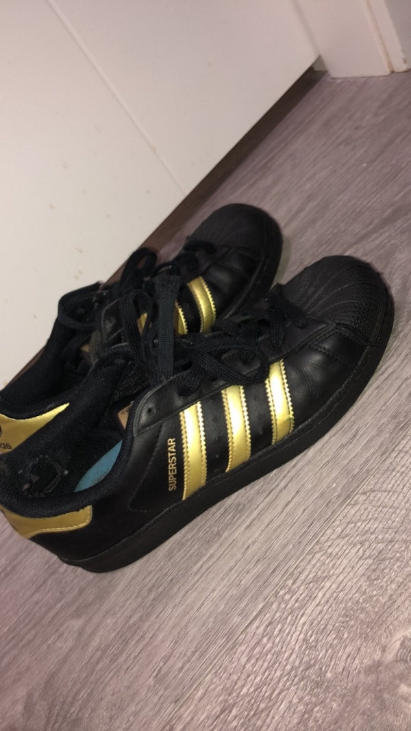 Black and gold adidas woman's size 7 Price might be negotiable