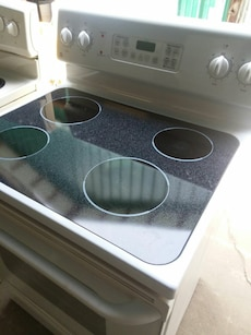 #1718 white GE glass top stove