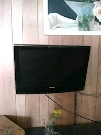 black flat screen TV with black wooden TV stand Warner Robins, 31093