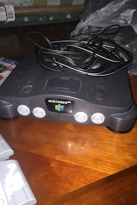 Nintendo 64, 7games, 4 controllers, and a ps4 game
