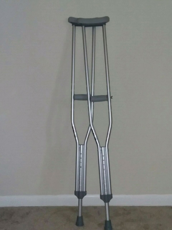pair of gray underarm crutches