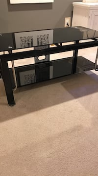 Black glass entertainment center table