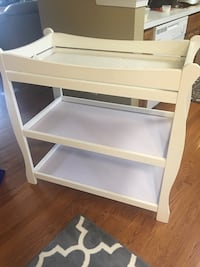white wooden 3-layer changing table