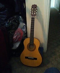 brown and black acoustic guitar Los Angeles, 90037