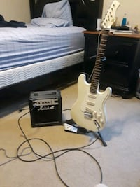 white electric guitar with amplifier 43 km