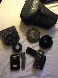 Black and gray camcorder with bag