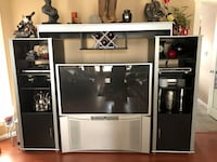 Silver and black wooden tv hutch and tv Edmonton