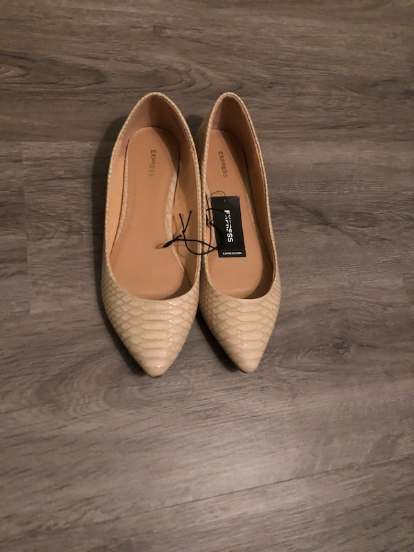 pair of beige pointed-toe flats