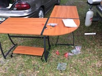 brown and black wooden picnic table Davenport, 33837
