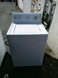 white top-load clothes washer 38 km