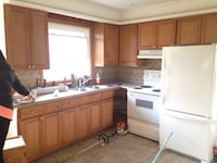 """wooden kitchen cabinet. Counter 105"""" approx 9 pcs plus sink.   With local delivery"""