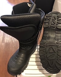 pair of black leather boots Toronto, M4S