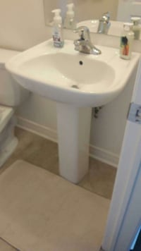 white ceramic toilet bowl with cistern Bradford West Gwillimbury, L3Z