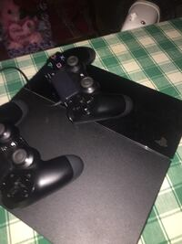 black Sony PS4 console with controllers Herndon, 20170