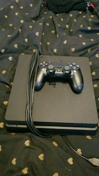 black Sony PS4 console with controller Germantown, 20874