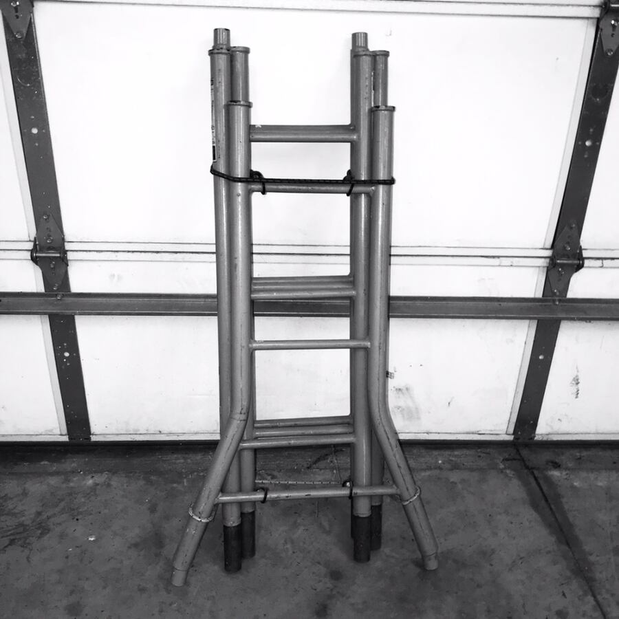 12 foot Steel 4 sectional steel ladder thats portable and storable