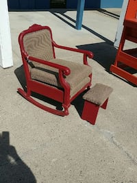 red wooden framed brown padded rocking armchair with ottoman