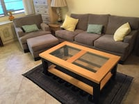 Gray suede sofa, Club chair and Ottoman, Coffee table, Black Carpet