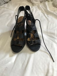 pair of black leather open-toe heeled sandals Houston, 77051