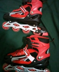 pair of red-and-black inline skates Winnipeg, R2M 1A5