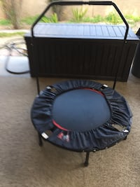 Black and red trampoline with handle bar Las Vegas, 89121